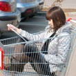 Pretty girl sits in a cart — Stock Photo
