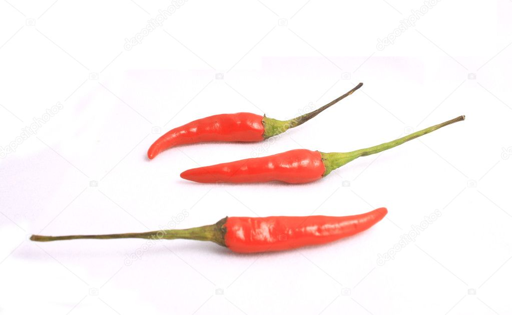 Three little red peppers on a white background. — Stock Photo #2841139