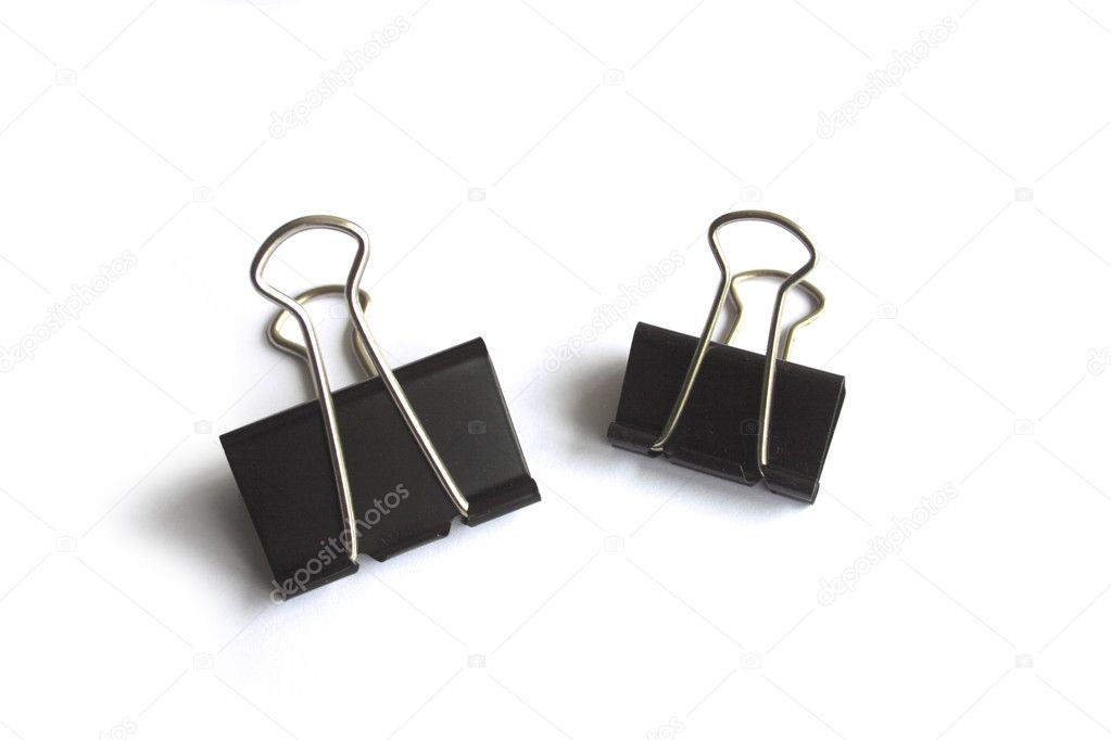 Two Black Metal Paper Clip On A White Background.   Stock Photo #2841365