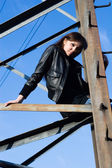 Woman on electrical tower — Stock Photo