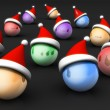 Christmas ball wearing santa hat greeting concept - Stok fotoraf