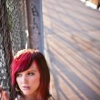 Portrait of young woman in urban area - Stock Photo