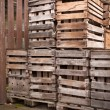 Old empty apple crates stacked up — Stock Photo