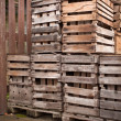 Old empty apple crates stacked up - Stock Photo