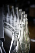 Recycling empty bottle to get refilled — Stock Photo