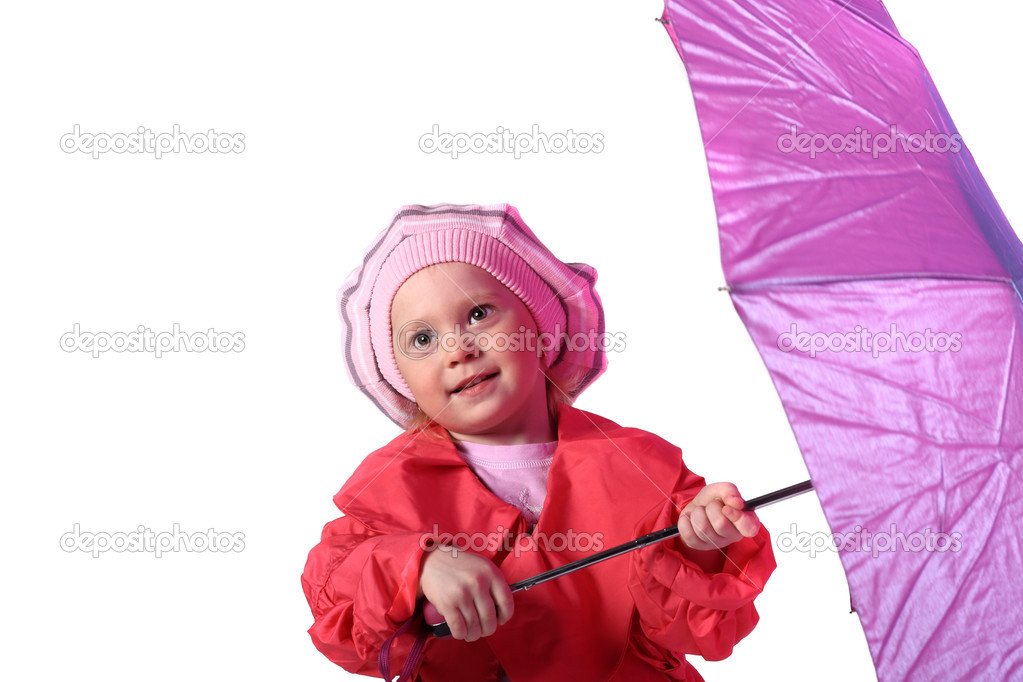 Cute little girl is standing with pink umbrella in her hands — Stock Photo #3059826