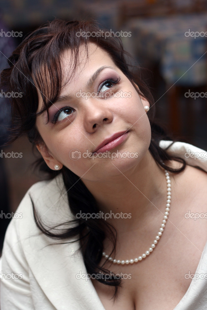 Young beautiful woman is looking up  Stock Photo #3687106