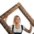 Royalty-Free Stock Photo: Bavarian girl with a frame isolated