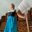 Royalty-Free Stock Photo: Bavarian girl outdoor with a shovel