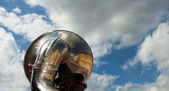 Brass tuba outdoors on a cloudy day — Stock Photo