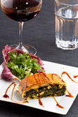 Slice of a spinach strudel on a plate — Stock Photo