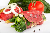 Rolled raw veal cutlets and assorted ingredients — Stock Photo