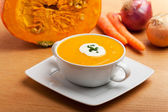 Pumpkin soup in a white bowl — Stock Photo