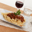Fusilli lunghi pasta and sauce bolognese on a plate — Stock Photo