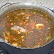 Stock Photo: Boiling soup in cauldron