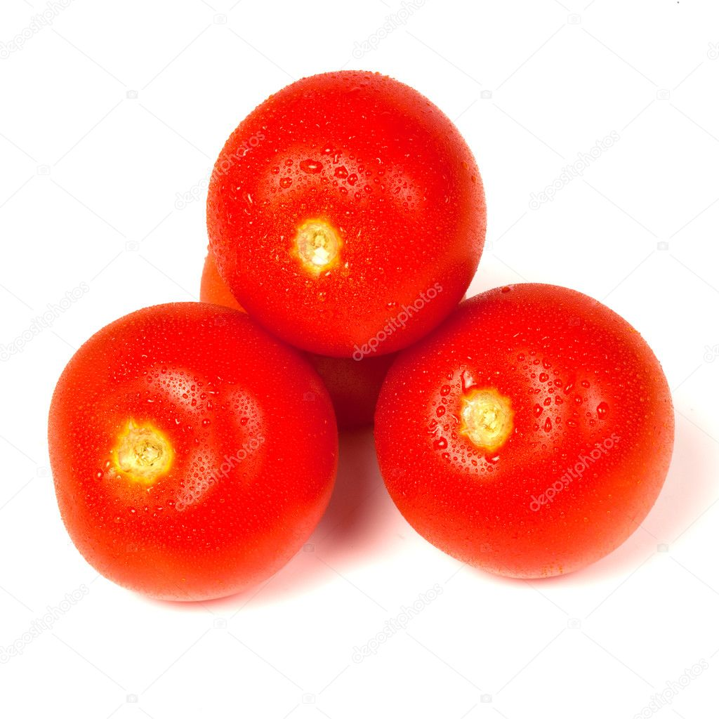 Tomatos in a pile with condensation glistening on them.  Stock Photo #3434554
