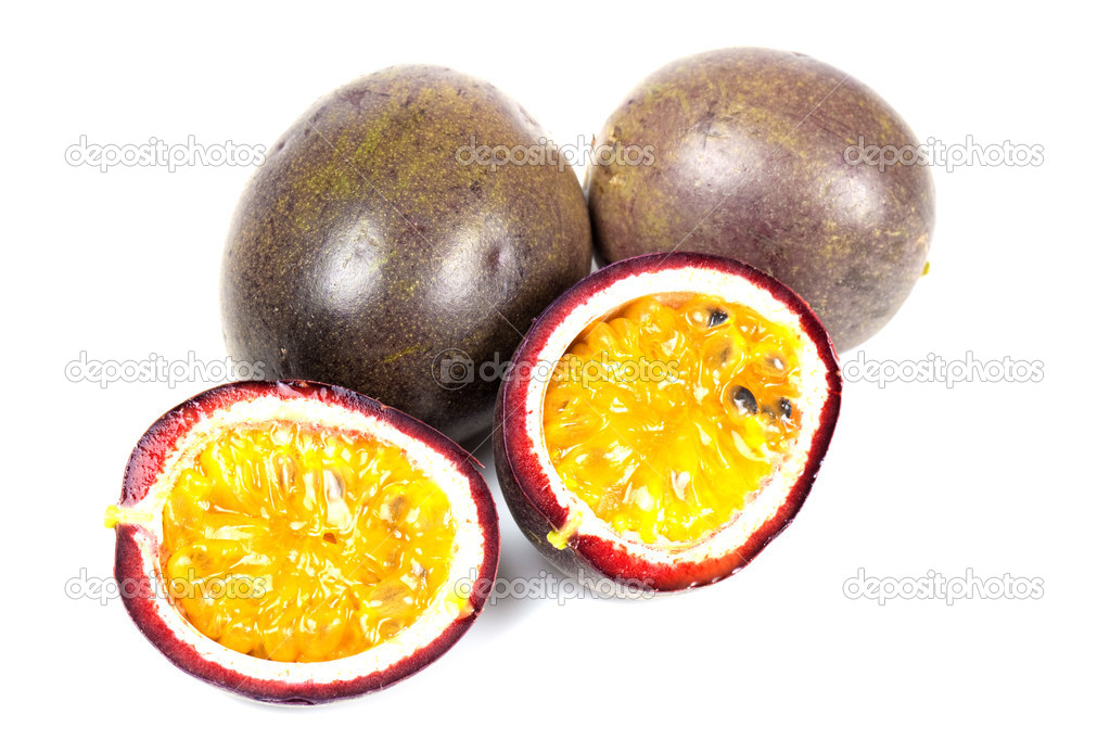 Some passion fruit with one cut in half — Stock Photo #3471436