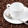 White espresso cup sat on coffee beans — Stock Photo #3763022