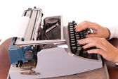Fingers on vintage typing machine on white — Stock Photo
