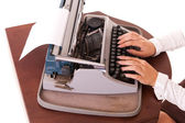 Vintage typewriter with long-nail female fingers — Stock Photo