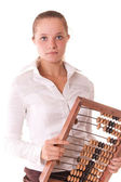 Serious young model with abacus — Stock Photo