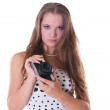 Young female model in polka dot dress posing with 35mm camera — Stock Photo