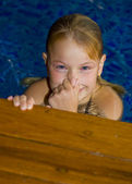 Cute preteen in a swimming pool — Stock Photo