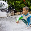 Cute boy playing with water — Foto Stock