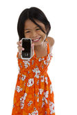 Cute girl showing her cellular phone — Foto de Stock