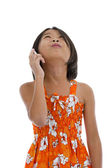 Girl with mobile phone looking up — Stock Photo