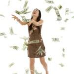 Pretty woman throwing money — Stock Photo