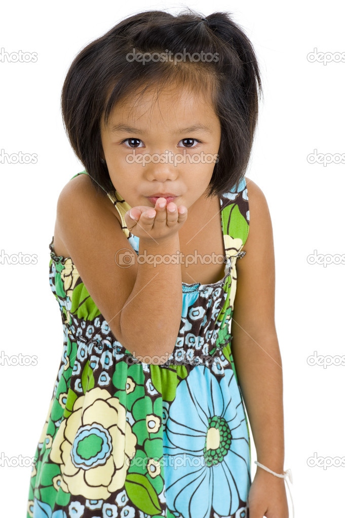 Beautiful little asian girl blowing a kiss, isolated on white background — Stock Photo #3766892