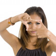 Young woman with finger frame — Stock Photo #3894601
