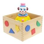 Игрушка клоун в деревянной коробке — Стоковое фото