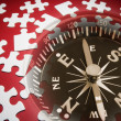 Jigsaw Puzzle Pieces and Compass - Stock Photo