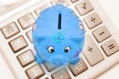 Calculator and Piggy Bank — Stock Photo