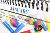 Calendar and Party Blowers — Stock Photo