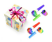 Gift Parcel and Party Blowers — Stock Photo