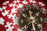 Jigsaw Puzzle Pieces and Compass — Stock Photo