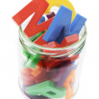 Stock Photo: Alphabets in Glass Jar