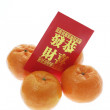 Mandarins and Red Packet — Foto de Stock