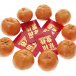Red Packets and Mandarins - Stock Photo
