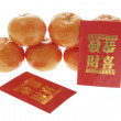Mandarins and Red Packets - Stock Photo