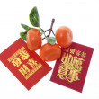 Mandarin Ornaments and Red Packets — Photo