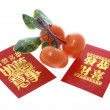 Tangerine Ornament and Red Packets — Stockfoto