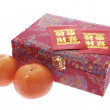 Mandarins and Red Packets — Stock Photo #3259446