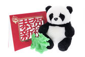 Toy Panda with Greeting Card and Jade Dragon — Stock Photo
