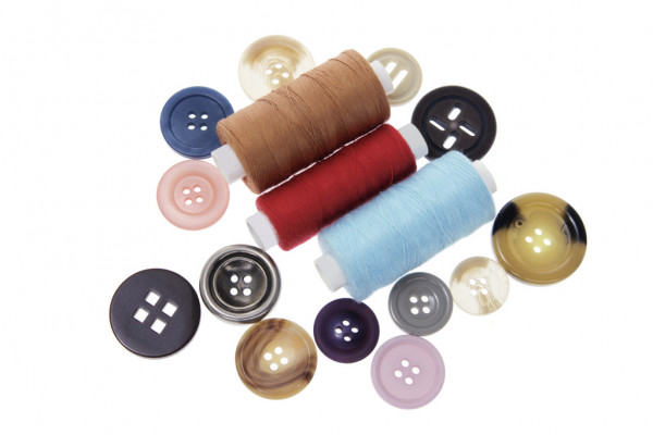 Buttons and Spools of Thread — Photo