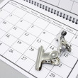 Stock Photo: Bulldog Clips on Calendar