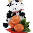Soft Toy Cow and Tangerine Ornament - Stock Photo